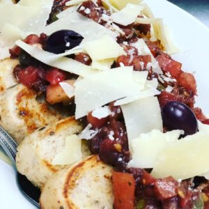 Bread toasted with aglio olio, tomato, onion, olive tapenade, and basalmic vinegar relish, parmesan, kalamata olives